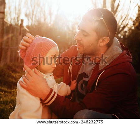 Vintage color photo,father talks to his daughter, father's day - concept. Sunlight on the sunset,  - stock photo