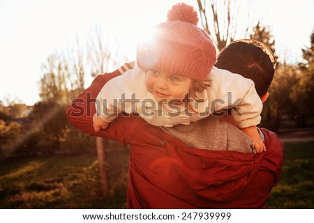 Vintage color photo happy joyful father having fun throws up in the air daughter, family, travel, vacation, father's day - concept. Sunlight on the sunset, spring day - stock photo