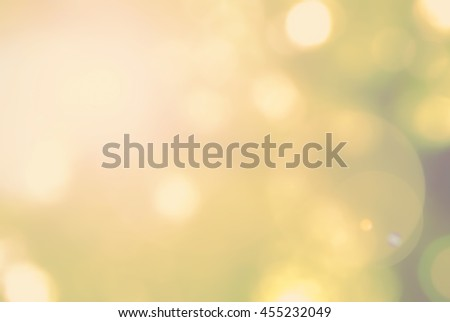 Vintage color tone blurred nature background of a view looking up through the foliage of a tree against the sky facing sun flare and bokeh: Blurry natural greenery view in cyan green blue color tone - stock photo