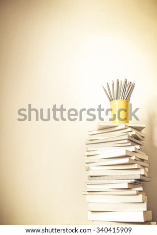 vintage color tone of Close up book stacked  with the  concrete wall background - stock photo