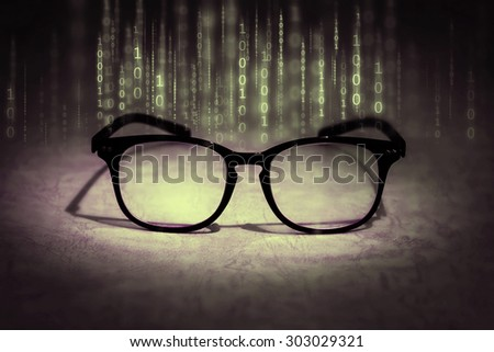 vintage color tone of  the reading eyeglasses absorb binary data , concept of future knowledge technology vision