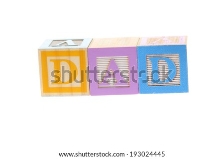 Vintage Colored wooden play block spelling dad on  Fathers Day - stock photo