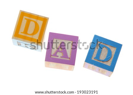 Vintage Colored wooden play block spelling Dad on Holiday - stock photo