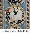 Vintage colorful carpet with Bird Phoenix useful for background  (Flea Market, Tel-Aviv). - stock photo