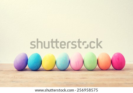 Vintage colorful easter eggs on wood table empty background - stock photo