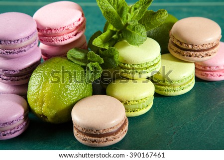Vintage colorful macarons on a green table