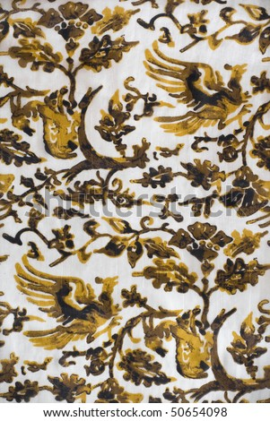 Vintage colorful textile with a flower pattern - stock photo