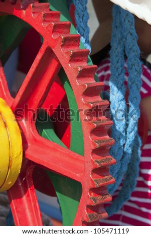 Vintage colorful winch on a boat to pull out the vessel from the sea and hoist the sail traditional cloth - stock photo