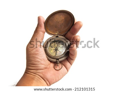 Vintage compass in hand on a white background - stock photo
