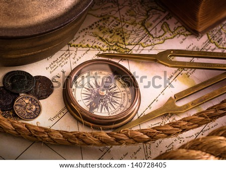 Vintage compass lies on an medieval map - stock photo