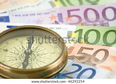 vintage compass on money background - stock photo