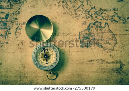 vintage compass on old map - stock photo