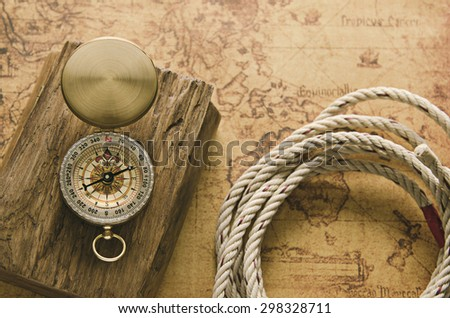 Vintage compass on old map