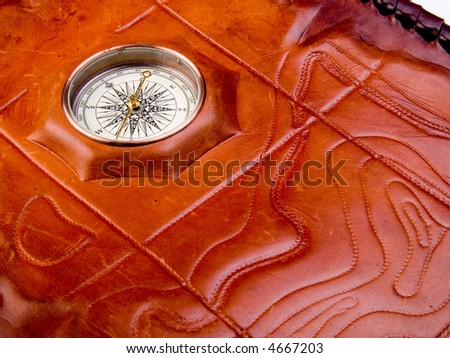Vintage compass on the leather texture - stock photo