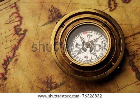 Vintage compass on the old map - stock photo