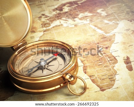 Vintage compass on the old world map with DOF effect. Travel concept. 3d - stock photo