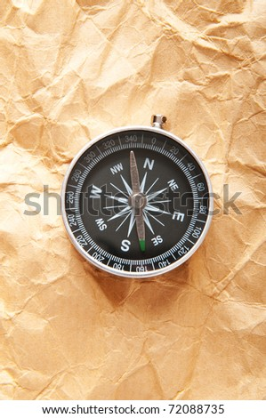 Vintage compass on the paper in adventure concept - stock photo