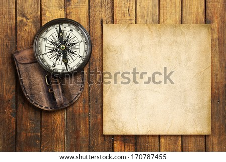 Vintage compass on the wooden background with the blank for your text - stock photo