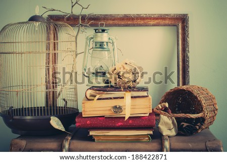 Vintage Composition with Albums, Dry Bouquet, Frame, Oil Lamp. Pastel colors - stock photo