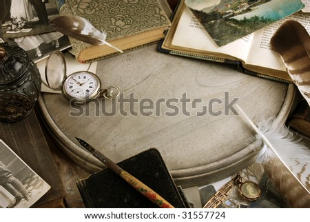Vintage composition with books and pocket clock - stock photo