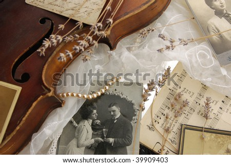 Vintage composition with old violin - stock photo
