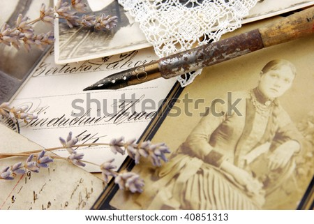 Vintage composition with pen and photos - stock photo