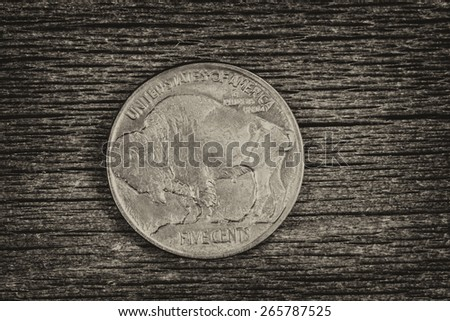 Vintage concept of Buffalo Nickel, reverse side, on rustic wood  - stock photo