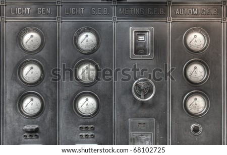 Vintage control panel with numerous gauges of an old steam machine - stock photo