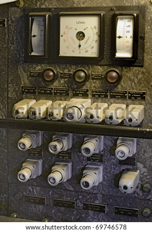 vintage controls with gauges and fuses - stock photo