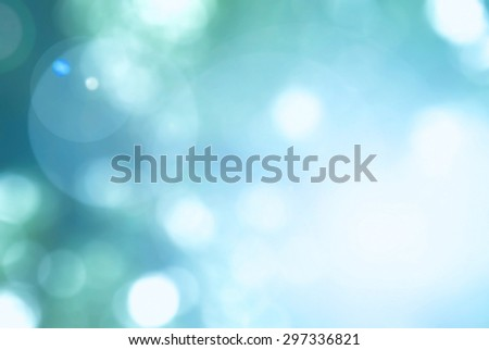 Vintage cool cyan blue green teal color tone blurred nature background of a view looking upward through the foliage of arbor tree against the sky facing sun flare and bokeh: Blur natural greenery   - stock photo