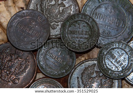 vintage copper coins of the Russian Empire in strong oxides - stock photo