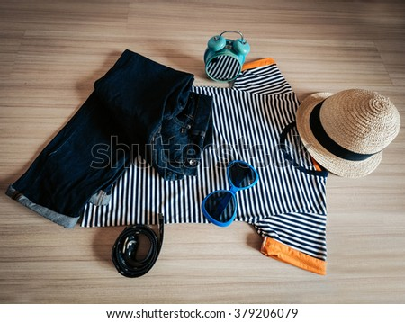 Vintage cozy clothing on a wood floor, close up sunglasses - stock photo
