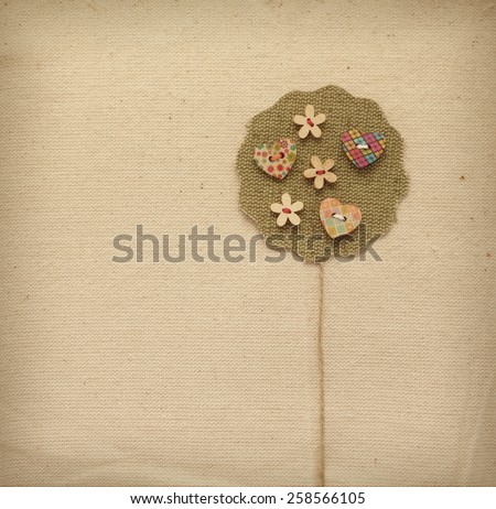 Vintage crafted tree -Thank you- background. Textile creative embellished with colorful flower and heart buttons. May be used for a graphic art, as a greeting or gift layout, brochure or web template.