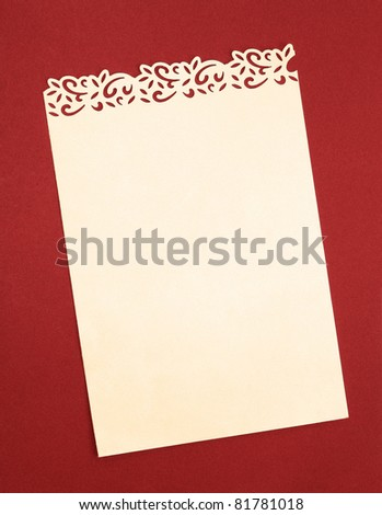 Vintage Cream Paper with Handmade Fancy Cutout Border isolated on Orange background - stock photo