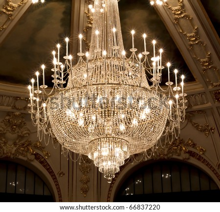 vintage crystal lamp inside theater - stock photo