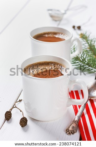 vintage Cup of hot cocoa or hot chocolate on wooden background decorated with spruce and pine cones, christmas concept - stock photo