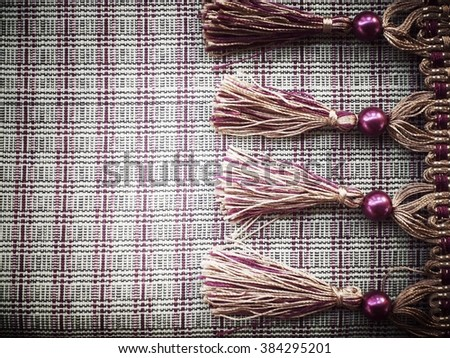 Vintage curtain laces on fabric - stock photo