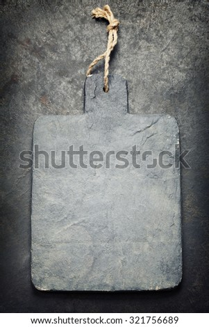 vintage cutting board with space for text on old metal background, close-up - stock photo
