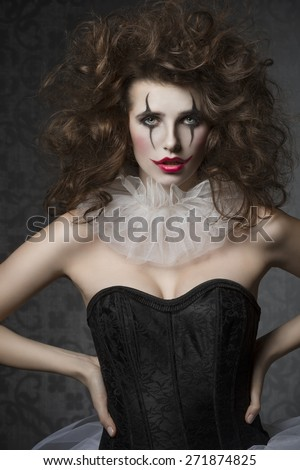 vintage dancer woman with gothic tutu, clown make-up and crazy hair-style. Creative fashion masquerade - stock photo