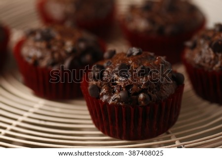vintage dark moody shot of homemade banana double chocolate with chocolate chip muffins