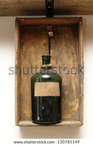 vintage decor with old chemical bottle on a wooden box - stock photo