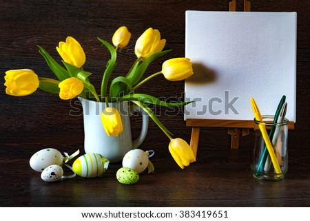 Vintage decoration with yellow tulips and easter eggs.  Dark toned picture