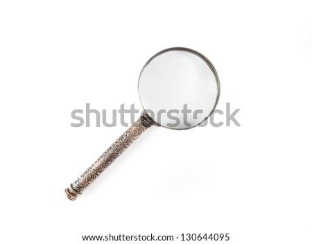 Vintage decorative magnifier isolated on white background - stock photo