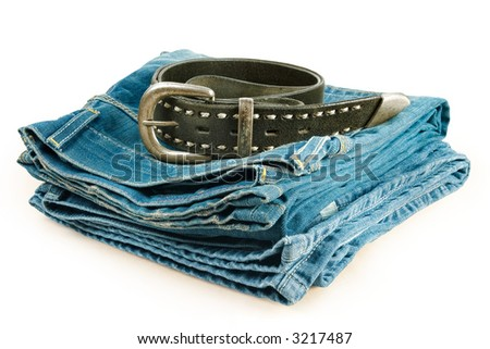 Vintage denim clothes-pile of jeans and leather belt - stock photo