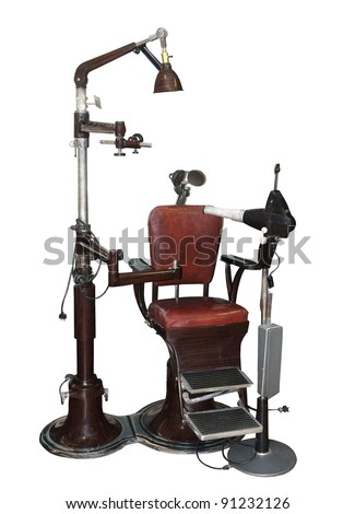 vintage dentist chair and equipment on a white background - stock photo