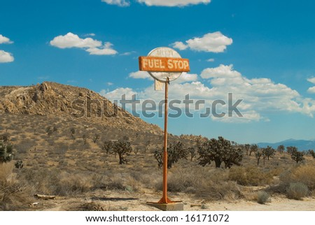 Vintage Desert Fuel Stop Sign on Highway