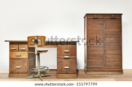 Vintage desk in a room with wooden floor - stock photo