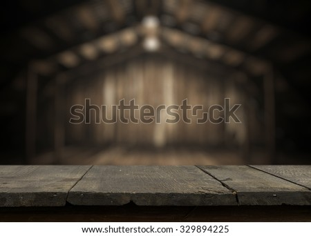 vintage desk in old wooden interior with light bulb - stock photo