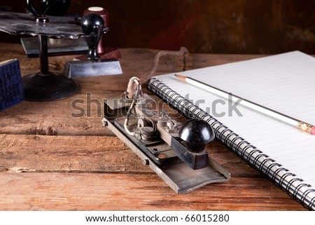 Vintage desk with antique telegraph and stamps - stock photo