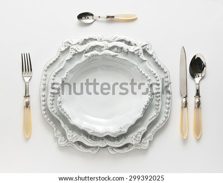 vintage dinnerware with cutlery isolated in plan